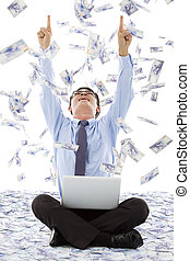excited business man raise hands with money rain background