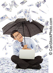 happy business man sitting on floor and holding a umbrella