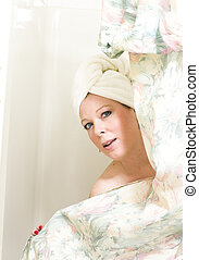 pretty woman after shower - pretty middle age woman drying...