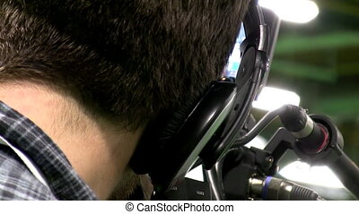 Close up of cameraman working - Back of the head of...