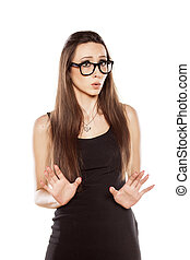 I'm not guilty - young woman with spectacles with a gesture...