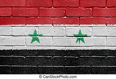 Flag of Syria on brick wall - Flag of Syria painted onto a...