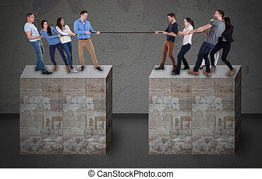 Friends Playing Tug-Of-War On Blocks - Group of young...