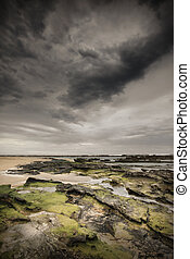 Storm clouds over Little Bay - Heavy storm clouds loom over...