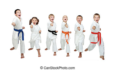 Six young athletes are hitting hand karate kick