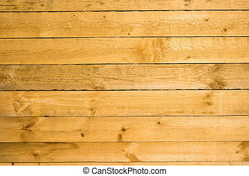Wooden crude uneven wall background - The wooden crude...