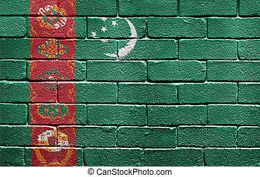 Flag of Turkmenistan on brick wall