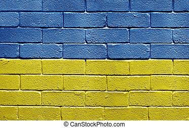 Flag of Ukraine on brick wall