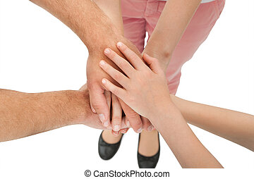Cropped Image Of Family Stacking Hands - Cropped image of...