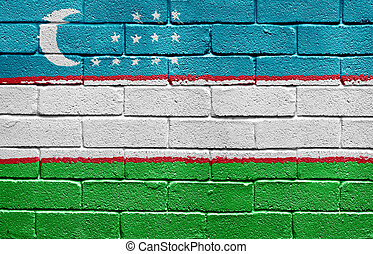 Flag of Uzbekistan on brick wall