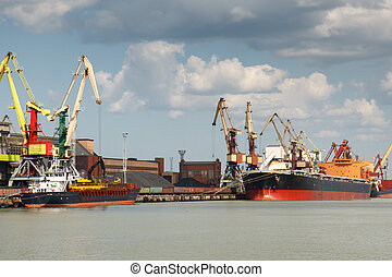 Harbor - Industrial harbor with two freight ships with coal...