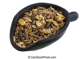 scoop of horse feed mix - horse feed with corn, barley, oats...