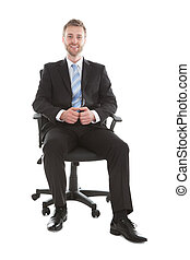 Confident Businessman Sitting On Office Chair