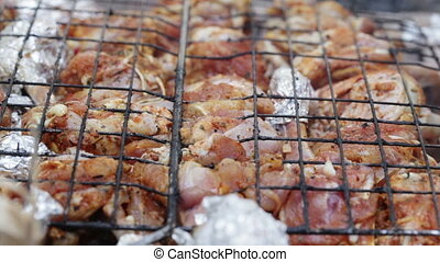 Chicken thighs on open fire