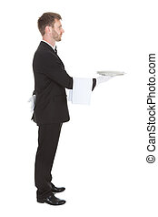 Side View Of Waiter Holding Empty Tray
