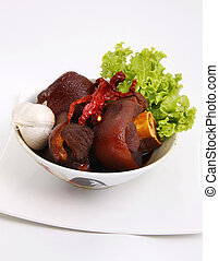 pig's trotters - a dish of pig's trotters cooked in garlic...