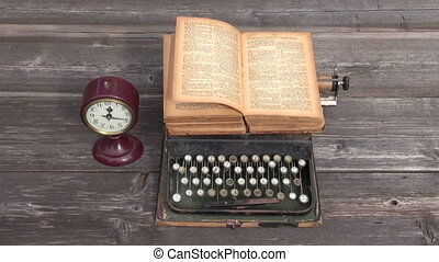 ancient typewriter and old book