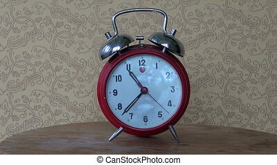 retro red alarm-clock on table