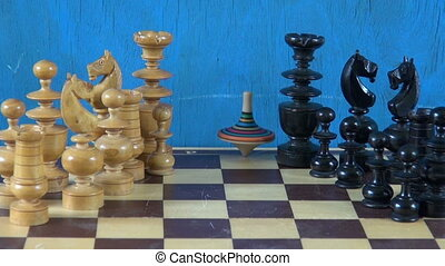 chess pieces on chessboard and toy - wooden chess pieces on...