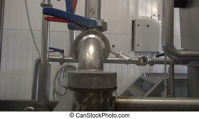 water splash in modern beer brewery - steel tube...