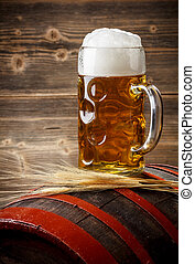 Glass of beer on a barrel