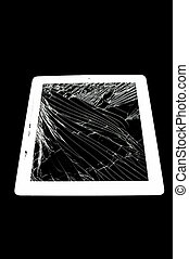 tablet computer with broken glass screen isolated on black...