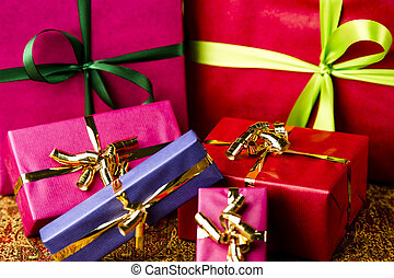 Six Bows Tied around Unicolored Gift Boxes - Four small and...