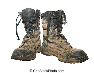 Dirty boots - A pair of dirty hiking boots isolated over...