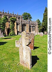 Church graveyard, Chipping Campden. - Old gravestones in the...
