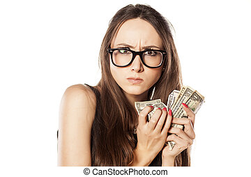 miser - stingy beautiful woman holding her money