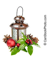 Christmas composition with lantern and holly berries on a...