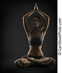 Yoga woman meditate sitting in lotus pose