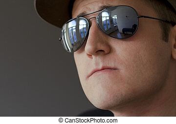 young male with hat and sunglasses