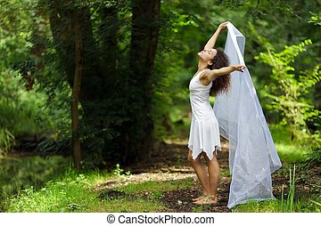 Beautiful woman in white - Beautiful barefoot woman in a...
