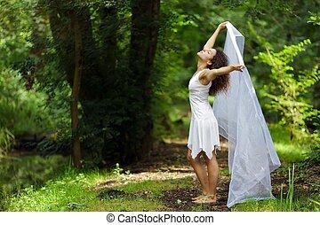 Beautiful woman in white - Beautiful barefoot woman in a...