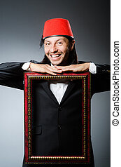 Man with fez hat and picture frame