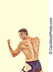 Muscular sports guy boxing ready to strike - Young muscular...