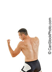 Young muscular sports guy with naked torso boxing holding...