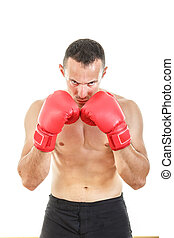 serious muscular man with connected red boxing gloves near his f