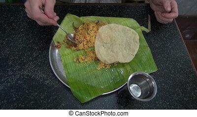 tourist eating vegetarian rice