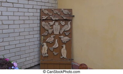 door with wooden carved birds - door with various wooden...