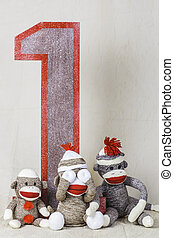 Sock Monkey Layout - Sock monkeys sitting around a wooden...