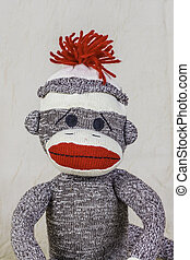 Sock Monkey Layout - A close shot of a sock monkey with...