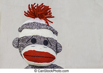Sock Monkey Layout - A close shot of a sock monkey with...