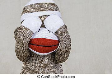 Sock Monkey Layout - A close shot of a sock monkey playing...