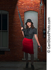 Woman with Assault Rifle and Handgun - Beautiful young woman...