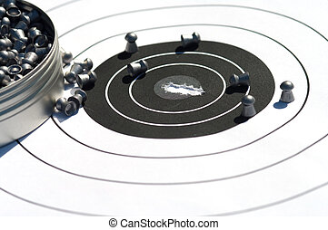 The punched target. - Target and bullets for the pneumatic...