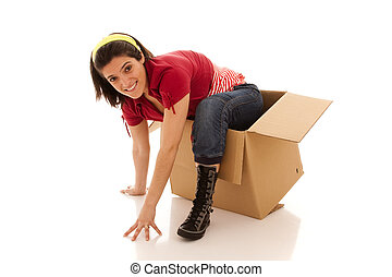 Thinking outside of the box - young woman leaving from a...