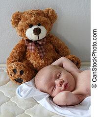 Baby - Cute newborn baby with a teddy bear