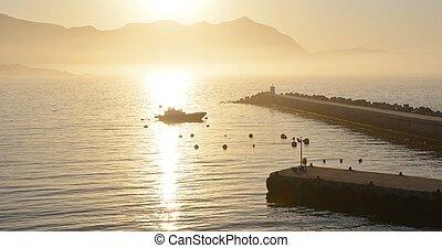 Sunrise - Seascape with sea and mountains at sunrise